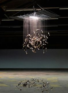 Johannes Vogl - Wolke (Clouds) - bottles - kinetic art installation - see a youtube video here also: http://www.youtube.com/watch?v=3gEmyE-ap48=plcp  once in a while a bottle falls and breaks
