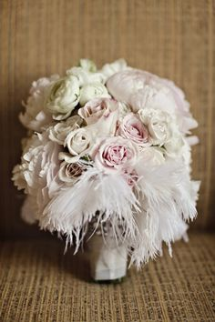 Pink and White Feather Bridal Bouquet... feathers are too wild for me! lol!