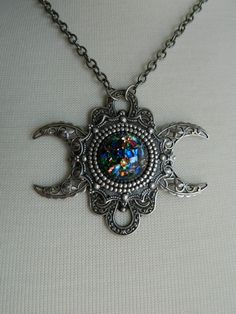 Triple Moon Goddess Necklace by Crow Haven Road. $45.00, via Etsy.