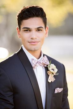 Giracci Vineyards Wedding Groom in Navy Lorenzo Tuxedo with black lapels with a Plaid Bow Tie and Pocketsquare