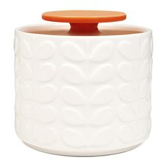 Bring Orla Kiely's signature style to the kitchen with this beautifully retro storage jar. Made from 100% earthenware it features the iconic Orla Kiely raised stem design in cream with a bright orange