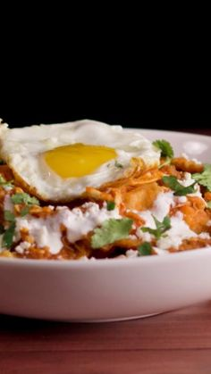 Chips and salsa topped with a fried egg is a dish you'll crave every morning.