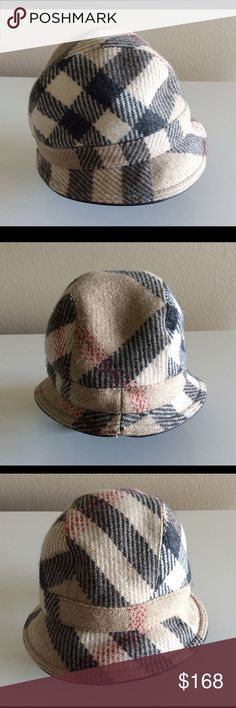 BURBERRY WOOL LEATHER TRIM HAT *100 AUTHENTIC* Worn it 3 times only. It is in good condition. The Burberry check with the leather trim are unique. It is beautiful. Burberry Accessories Hats