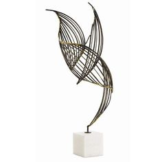 The chai sculpture creates light dramatic movements with natural iron and brass welds on a solid white marble base. A stunning work of art at any angle. Dimensions 8W 31.5H 6.5D