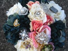 Bridal bouqet with broches...how fabulous.