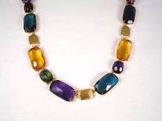 From the Marco Bicego Murano Collection, this 18K Yellow Gold Mixed Stone #Necklace Features Amethyst, Citrine, Blue Topaz, Garnet, Green Tourmaline, and Iolite.  #jewelry