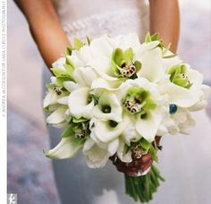 Bouquet!! Calla lily and orchid.  I like that this is mostly white with touches of green and purple.  Something like this would be beautiful.