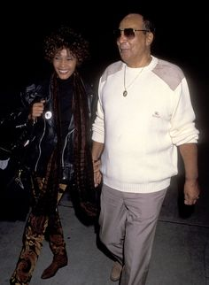 Whitney Houston Photo Gallery: Arriving with father John Houston at Los Angeles International Airport October 9, 1991.