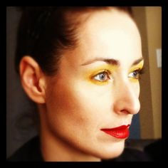 VMMA Makeup model showing advance students work (yellow eyes red lips)