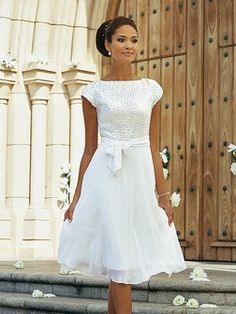 Short wedding dress with cap sleeves.