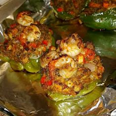 NGREDIENTS: 6 medium bell peppers 1/2 stick butter 1/2 pound lump crab meat 1/2 pound small shrimp, peeled and deveined 1/2 pound crawfish tails 2 cloves garlic, minced 1/2 cup onions, chopped 1/2 cup bell pepper, chopped 1/2 cup celery, chopped 1/4 cup fresh parsley, chopped 1 tablespoon Cajun seasoning couple good shakes of hot...