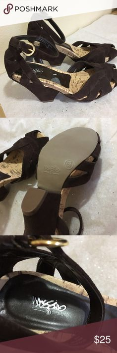 """Shoes New, never worn. Brown suede heels with ankle strap.  4"""" heel with 1/2"""" cork wedge. Size 61/2. Has a small spot on inside of shoe where sticker made a spot. Mossimo Shoes Platforms"""
