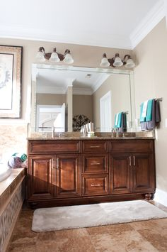 Double sink with dark cabinets.