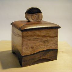Red oak box, exotic lid, cedar handle & a little hand staining.  more info at carvededge@gmail.com :)