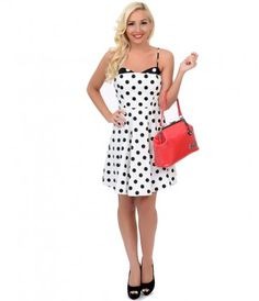 You've hit the sweet spot, dear! A cheeky white frock to flaunt, with a smattering of bold black polka dots and subtle c...Price - $52.00-3dPxQp1F