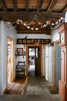 Eclectic white hallway with vintage accessories in Hallway Colour Ideas. A…