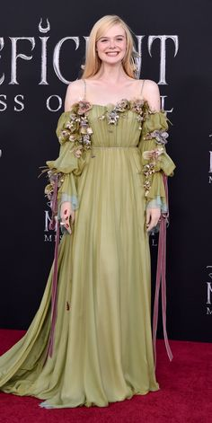 At the Maleficent: Mistress of Evil premiere, Elle Fanning wore a sage green Gucci gown, which was accented with flowers and crystal straps. Elle Fanning, Beautiful Dresses, Nice Dresses, Prom Dresses, Gucci Gown, Fantasy Gowns, Elle Fashion, Fairy Dress, Maleficent