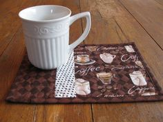 I have the fabric used in this mug rug! I was going to make a bag with it but I like this better :)