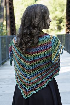 Tangier is a yarn with a long, slow color change. This makes it perfect for crochet, because it doesn't cause crazy color pooling. By using basic stitches, this shawl lets the yarn do all the work, creating beautifully blended stripes.