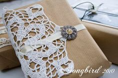 Vintage doily, broach and ribbon dress up brown paper - Christmas Gift Wrapping…