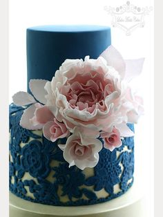 Close-up of navy blue lace over gold wedding cake tier and that pink peony!