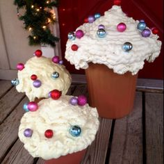 "(I cannot find a source) Cheap flower pots and expanding foam to make cupcakes! And obviously some ornaments as ""sprinkles"". What a neat Christmas display or kid's party display! Candy Land Christmas, Christmas Gingerbread, Noel Christmas, Christmas Crafts, Christmas Porch, Christmas Cupcakes, Christmas Lights, Outside Christmas Decorations, Gingerbread Decorations"