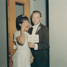 Old Vintage Photograph Man With Bride Winking & Holding Do Not Disturb Sign