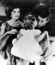 President John F. Kennedy with his daughter and first lady, Jackie Kennedy