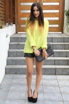 Neon sweater. Leather shorts. Black shoes.