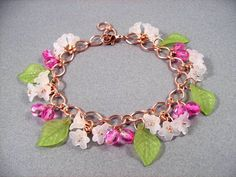 Flower Charm Bracelet White Pink and Green Rose by justCHARMING, $26.00 https://www.etsy.com/listing/83772903/flower-charm-bracelet-white-pink-and