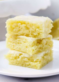 Lemon brownies AKA lemon blondies are super soft and moist bars topped with the most delicious lemon glaze. The perfect refreshing dessert that you'll be making over and over again! Lemon Dessert Recipes, Köstliche Desserts, Lemon Recipes, Summer Desserts, Sweet Recipes, Baking Recipes, Easy Lemon Desserts, Brownie Desserts, Plated Desserts