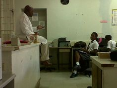 Dr Alfred Sparman giving a careers talk to students at Combermere School, Barbados