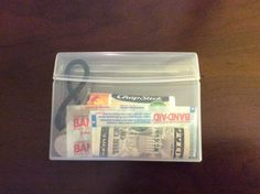 Purse survival kit! The container is from a 35-piece pack of Extra chewing gum. After we chewed all the gum we took the paper out and it was ready to be used for the kit! Contents:  3 pieces of chewing gum 3 band-aids 1 stick of Chapstick 3 mini clear hair ties 1 big hair tie 1 $5 bill 3 bobby pins