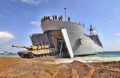Korean Amphibious Ship (LST) Sungoonbang unloading a Republic of Korea Type 88 K1 Main Battle Tank during a 2004 military joint military exercise at Pohang Beach, South Korea.