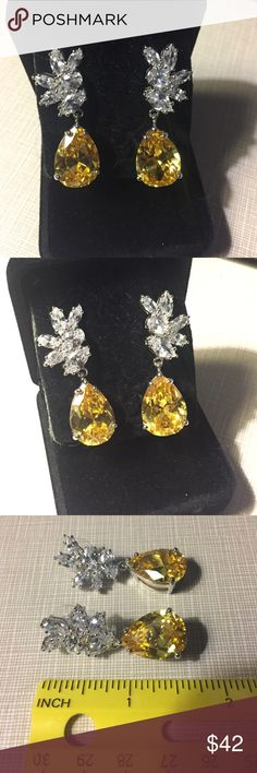 Marvelous party Cz earrings golden citrine tone So sparkly and gorgeous party earrings to make a big entrance with class well done approximately 1'3/4 long to over 1/2'wide is elegant sophisticated brand new pear shaped citrine color faceted stones fine fashionable jewelry nwot Jewelry Earrings
