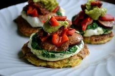 "Fun breakfast idea: Zucchini ""pancakes"" topped with eggs, spinach, sausage, avocado, and diced red pepper! #paleo"