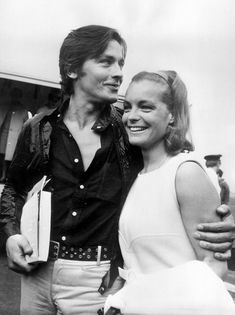 """Alain Delon, come welcome Romy Schneider, at the airport of Nice, French Riviera, on August 12, 1968, before the shooting of """"La Piscine"""" (""""The Swimming pool"""") by Jacques Deray, in Ramatuelle and Saint-Tropez. Photo by Jean-Pierre Bonnotte / Gamma-Rapho."""