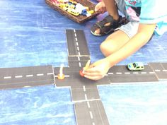 Printable roads from Pinterest made and glued on cardboard. Kids love them 2013