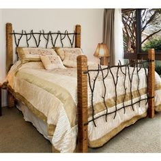 Pictured here is the South Fork wrought iron and wood bed handcrafted by artisan blacksmiths.