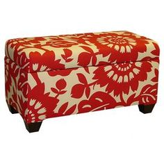 """Wood storage bench with floral cotton upholstery and foam cushioning. Handmade in the USA.   Product: Storage ottomanConstruction Material: Cotton and woodColor: Cherry redFeatures: Handmade in the USADimensions: 21.5"""" H x 39"""" W x 19.5"""" D"""