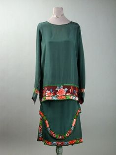 Callot Soeurs Green Orientalist Ensemble  French, 1920s  The tunic and skirt trimmed with Chinese inspired multicolored flowers, labeled: Callot Soeurs/ Paris/Nouvelle Marque Deposee.  Good condition, waist alteration.   Sold for $650