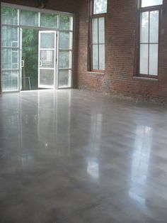 """This commercial/residential concrete floor was renovated with a new poured concrete surface which was ground and densified. The concrete was diamond polished to a 1500 grit finish for a glossy look and sealed with Versaguard sealer."" Glossy, Shiny, Polished Concrete Diamondtech, Inc Plains, PA"
