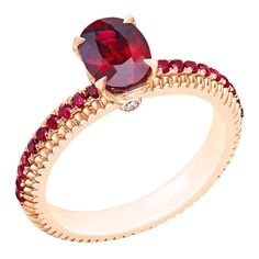 Faberge engagement ring featuring rubies in a delicate, fluted setting with matching pavé gems