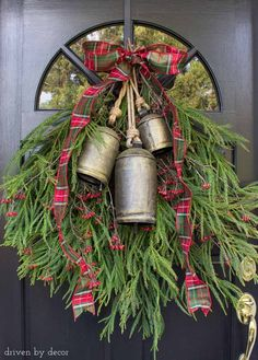 A simple greenery swag with bells to decorate your front door for Christmas - love! #wreath #greenery #bells #christmas
