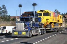 Kenworth custom W 900 heavy haul with train car on wagon