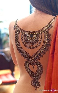 Bejewelled, elaborate back henna by www.hennalounge.com
