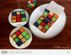 Rubik cube cake! i made a cake like this with a chessboard pattern. i never thought to add colours.;]