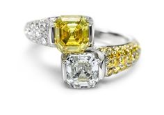 Dynamic ring 18kt white gold with Royal Asscher Cut diamond and yellow sapphire, white diamonds and yellow sapphires pave