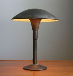 Vintage table lamp in very good vintage condition. It is obviously inspired by the Gaurdsman lamps by Faries. The lamp has what looks like a very heavily patinated bronze finish over steel.