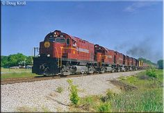 It's very hard to find such lashups today; five of the A's C420s (nearly half of the fleet) led by #46 have the southbound Fort Smith turn at Greenwood, Arkansas on May 14, 1999.